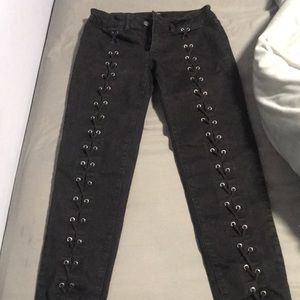 Black ankle jeans that are laced up